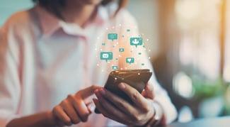 Woman-Hand-Using-Smartphone-social-media-engagement-social-selling