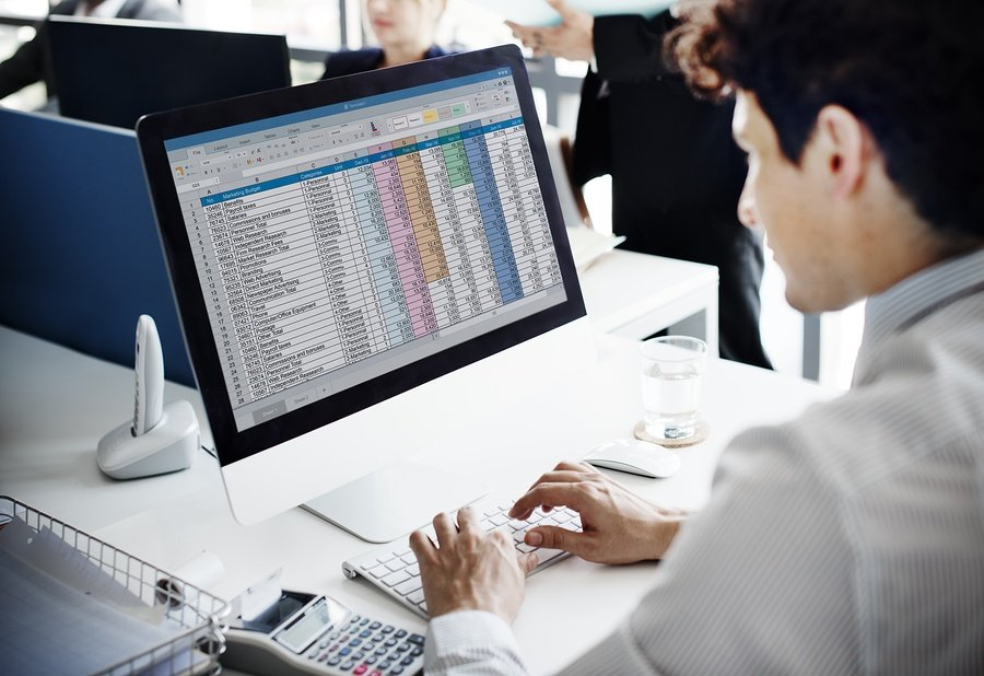 bigstock-Businessman-Working-Accounting-117820013.jpg