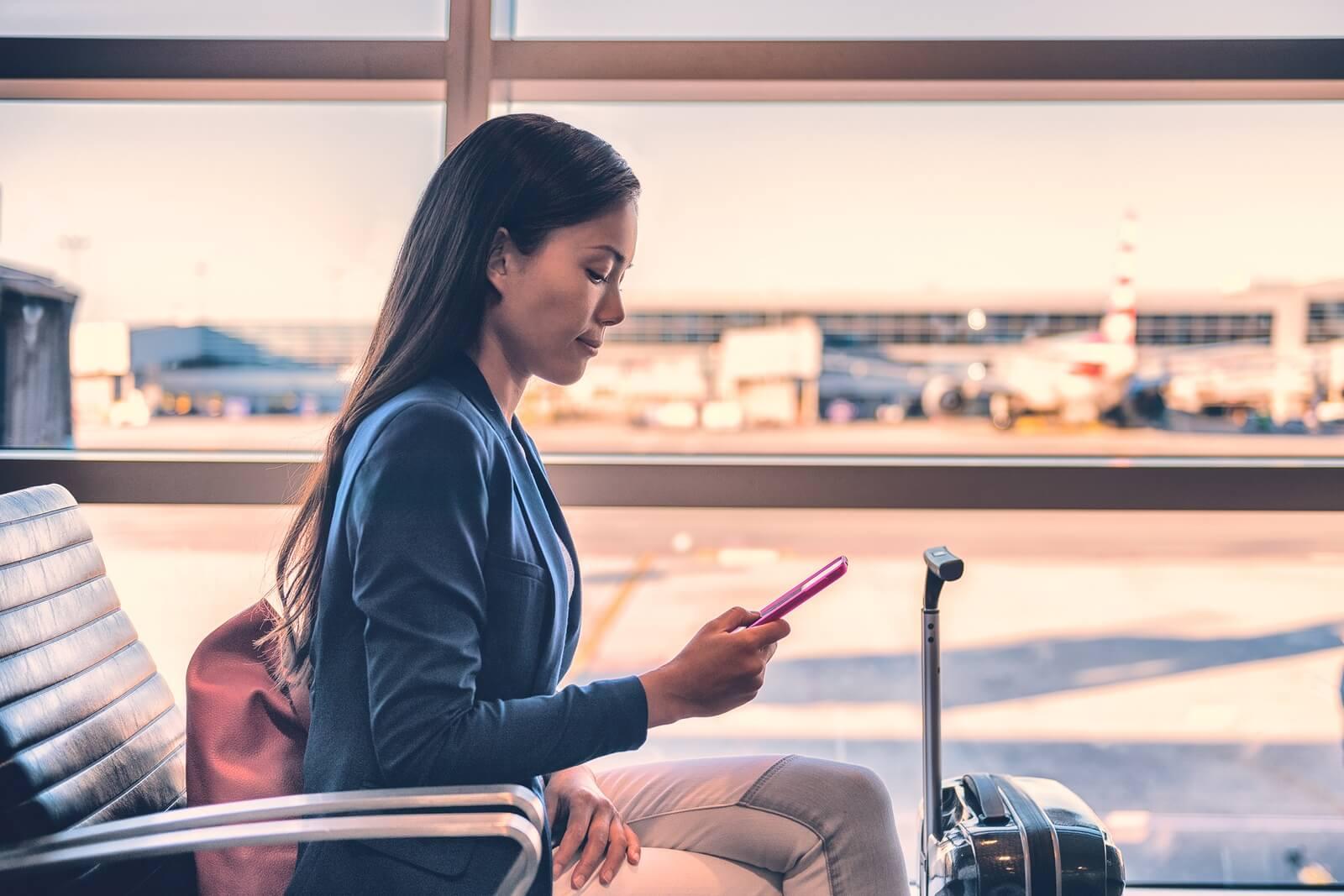 bigstock-Airport-phone-travel-Asian-bus-248638177