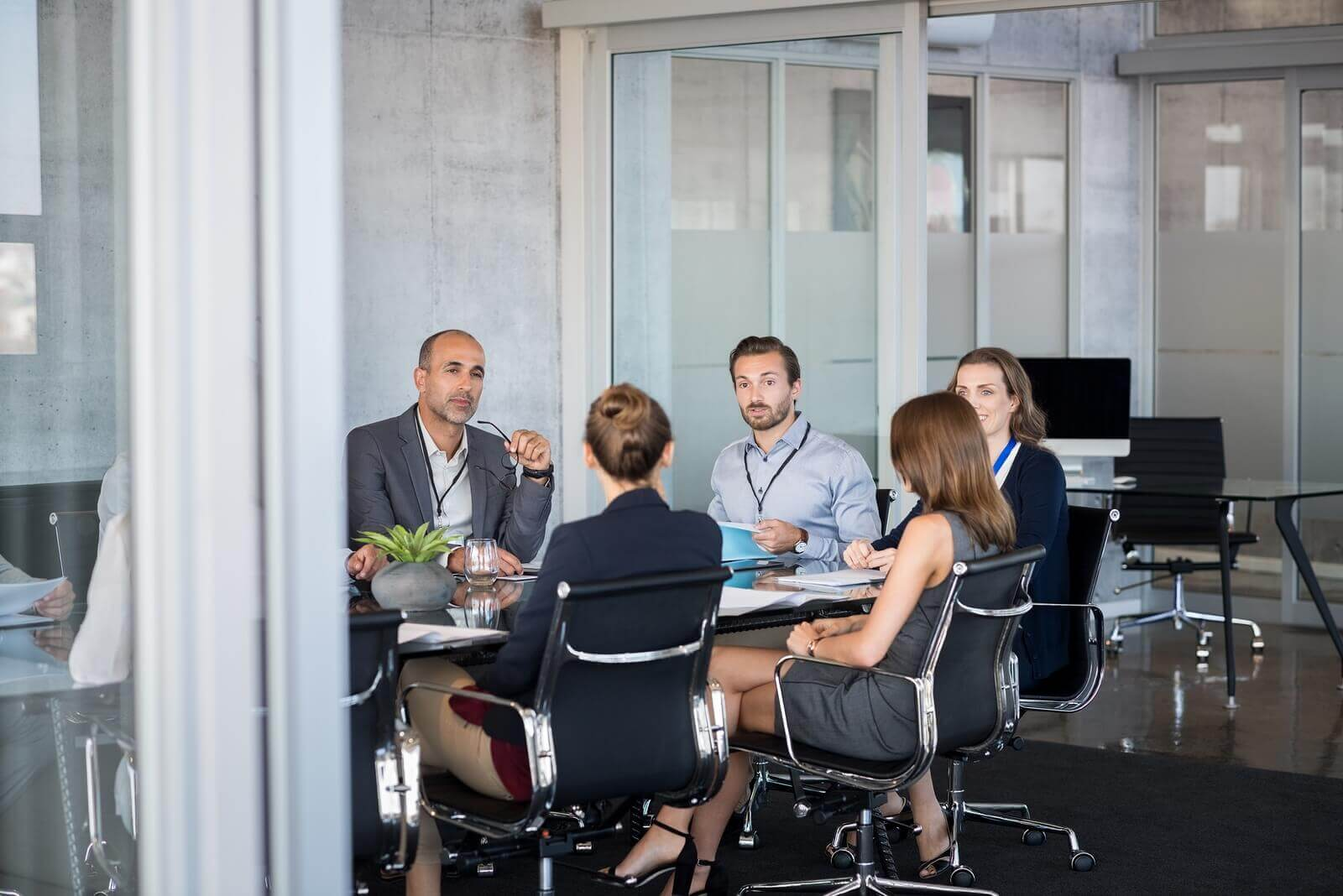 bigstock-Business-people-sitting-in-boa-206016238