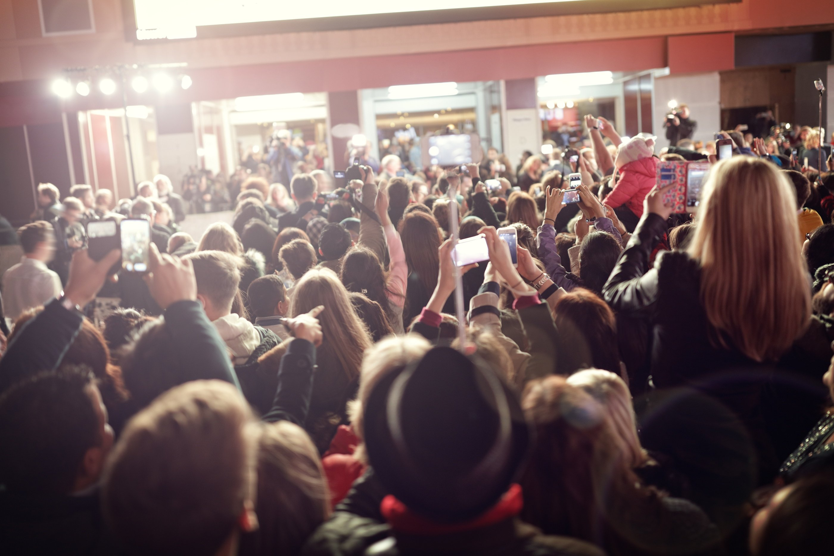 bigstock-Crowd-and-fans-taking-photogra-128205884