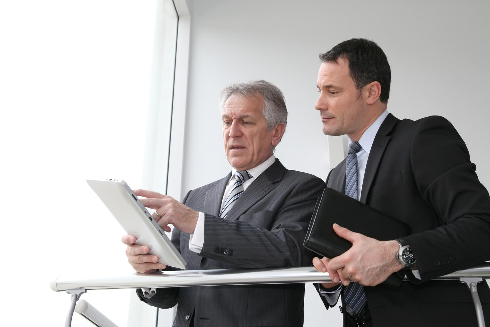 bigstock-Sales-people-working-on-electr-17010287
