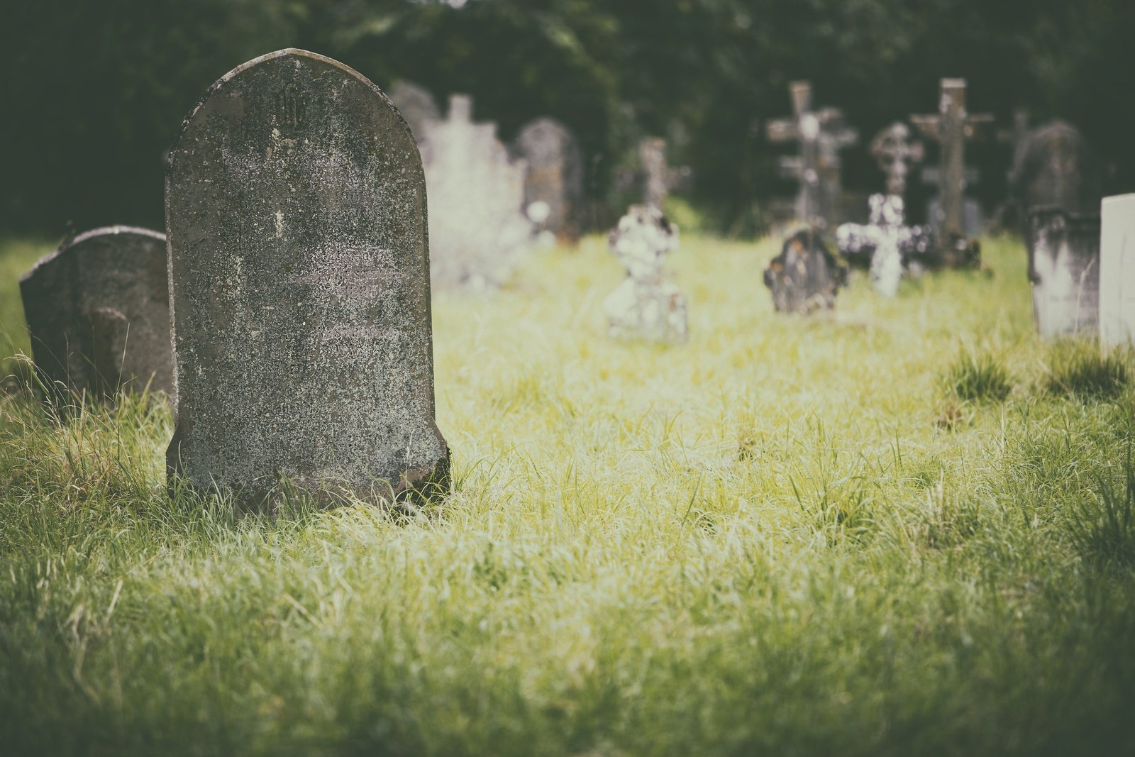 bigstock-Tombstone-and-graves-in-an-anc-154497446